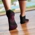 Gaiam Antislip sokken zwart met roze stippen (S/M)  G05-57126
